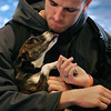 Salem:<br /> Cory Donahue, a sophmore, cradles Diago in his arms as Diago licks Cory's chin at Salem State University. The Northeast Animal Shelter brought dogs to Salem State for students to visit with as stress relief during final exams.<br /> Photo by Ken Yuszkus/The Salem News, Wednesday, December 12, 2012.