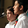 "Beverly Briscoe 6th graders Cameron Capachietti, left, and Daniel Cuoco, right, perform a duet singing ""Grandma Got Run Over By A Reindeer"" during the winter concert on Thursday evening. David Le/Staff Photo"