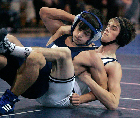 Danvers:<br /> Peabody's Larry Driscoll, left, is entwined in the hold of St. John's Prep's D.J. Lemieux at the St. John's Prep wrestling quad-meet. Lemieux won the match with a pin in the 126 weight class,  .<br /> Photo by Ken Yuszkus/The Salem News, Monday, December 24, 2012.