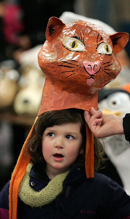 Beverly:<br /> Lidia Miedema, 4, tries a costume which she can wear in the Grand Procession at Beverly's New Year.<br /> Photo by Ken Yuszkus/The Salem News, Monday, December 31, 2012.
