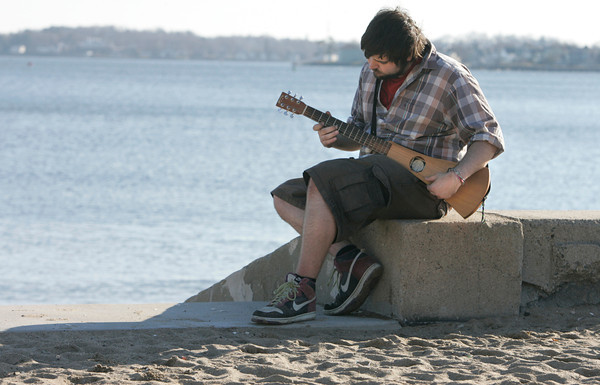 Beverly:<br /> John Madulka wearing shorts and rolled up shirt sleeves plays his guitar in the warm afternoon sun while at Dane Street Beach. Warmer temperatures will be around for a few days.<br /> Photo by Ken Yuszkus/The Salem News, Monday, December 3, 2012.