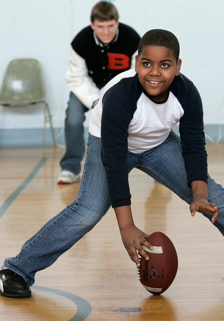 Danvers:<br /> Beverly School for the Deaf student Brian Jiminez is ready to hike the ball to Beverly football player Kenny Pierce.<br /> Photo by Ken Yuszkus/The Salem News, Thursday, December 20, 2012.