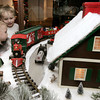 Wenham:<br /> Lucas Mone, left, 23 months old and his brother Liam, 3, from Salem, watch the train pass by in one of the train setups at the Wenham Museum.<br /> Photo by Ken Yuszkus/The Salem News, Friday, December 21, 2012.