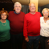 From left, Jim and Mary Laramie, and Alison and Tom Murray, all of Marblehead, at the Salem Children's Charity Christmas Party at Victoria's Station in Salem. David Le/Staff Photo