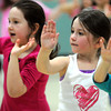 Danvers:<br /> Dianna Hoga, 6, left, and Shannon Driscoll, 6, in hip hop dance class during the Hip Hop Girls Club program at the Thorpe School in Danvers this week.<br /> Photo by Ken Yuszkus/The Salem News, Tuesday, February 19, 2013.
