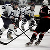 Peabody:<br /> Peabody's Eric Hennessey brings the puck down ice with Beverly's Nick Albano closing in during the annual Carlin Cup hockey game with Beverly and Peabody.<br /> Photo by Ken Yuszkus/The Salem News, Monday, February 18, 2013.