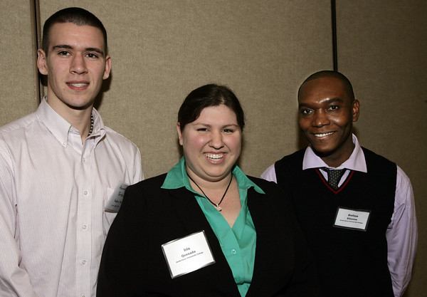Peabody:<br /> From left, Keane Terenzoni of Salem State University, Iris Quesada and Gelin Etienne both of the North Shore Community College attend the 7th annual tourism summit presented by the North of Boston Convention and Visitors Bureau at the Peabody Marriott.<br /> Photo by Ken Yuszkus/The Salem News, Friday, February 1, 2013.