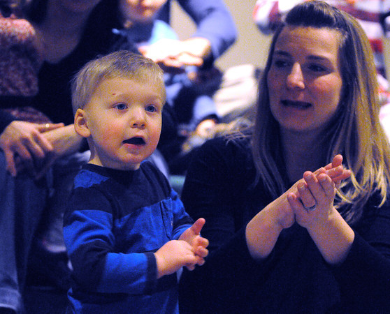 Beverly:<br /> Samuel Deroche, 2 1/2 years old, and his mother Kelly clap and sing a song during the Toddler Story Time at the Beverly Public Library on Wednesday morning.<br /> Photo by Ken Yuszkus/The Salem News, Wednesday, February 20, 2013.