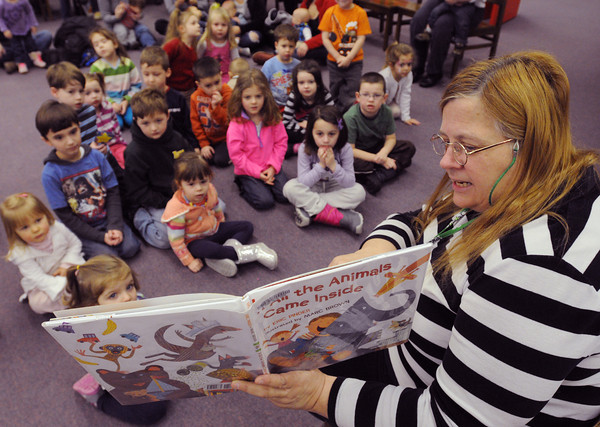 """Danvers:<br /> Head of childrens services Joanne Powell reads the book """"If All the Animals Came Inside"""" by Eric Pinder to a group of children at the Peabody Institute Library of Danvers on Wednesday.<br /> Photo by Ken Yuszkus/The Salem News, Wednesday, February 6, 2013."""