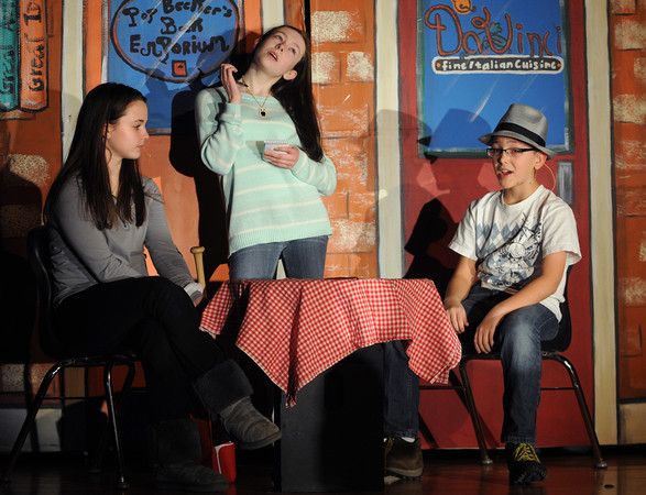 """Danvers:<br /> From left, Julie Webster as Blousey, Aurora Hannisian as the waitress, and Trevor Hathaway as Bugsy Malone Jr, practice their lines during the """"Bugsy Malone Jr."""" rehearsal at Holten Richmond Middle School. """"Bugsy Malone Jr.,"""" is a spoof of gangster films that is set in the roaring 1920s. The production involves more than 100 students and is directed by HRMS Drama Teacher Cherry Bennett. Performances are 7 p.m. Friday, Feb. 8 and 1 p.m. and 7 p.m. Saturday, Feb. 9. Tickets are $10 at the door. To order them in advance, call Kathy Lopes 978-774-2039 or email kathyml2378@aol.com.<br /> Photo by Ken Yuszkus/The Salem News, Tuesday, February 5, 2013."""