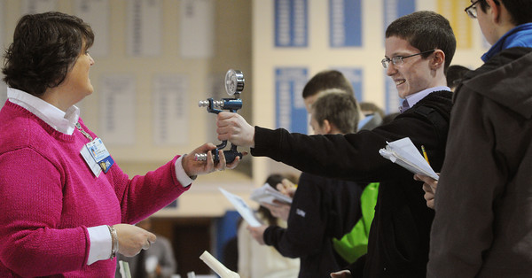 Danvers:<br /> Patty Goodwin from the Lahey Clinic instructs St. John's Prep freshman Zach Maccario in the use of a dynamometer which measures grip strength during the first ever wellness fair for students at St. John's Prep. <br /> Photo by Ken Yuszkus/The Salem News, Thursday, February 28, 2013.