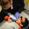 Salem:<br /> Dental hygenist Ellen Gould works on kindergartener Christian Toribio at Witchcraft Heights Elementary. Personnel from the nonprofit group Polished administered cleanings, floride treatments, and sealants on some of the students at the school.<br /> Photo by Ken Yuszkus/The Salem News, Tuesday, February 5, 2013.