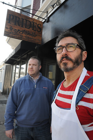 Beverly:<br /> Owner Michael Magner, left, and executive chef Paolo Laboa stand in front of Prides Osteria restaurant.<br /> Photo by Ken Yuszkus/The Salem News, Friday, February 15, 2013.