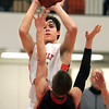 Beverly:<br /> Beverly's Jonathan Berchoff shoots for the basket with Salem's Billy Muse covering during the Salem at Beverly boys basketball game.<br /> Photo by Ken Yuszkus/The Salem News, Friday, February 15, 2013.