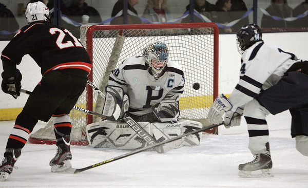 Peabody:<br /> Peabody's goalie Joe Powers repelled  Beverly's  Graham Doherty's shot at the goal during the annual Carlin Cup hockey game with Beverly and Peabody.<br /> Photo by Ken Yuszkus/The Salem News, Monday, February 18, 2013.