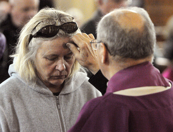 Salem:<br /> Joanna Pawlik receives ashes from Father Lawrence Rondeau on Wednesday, the beginning of Lent, at St. James Church in Salem.<br /> Photo by Ken Yuszkus/The Salem News, Wednesday, February 13, 2013.