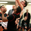 Beverly:<br /> Beverly's Cam Rogers goes up for a shot at the basket with Salem's Billy Muse, left, and Salem's Jared Louf-Woods covering during the Salem at Beverly boys basketball game.<br /> Photo by Ken Yuszkus/The Salem News, Friday, February 15, 2013.