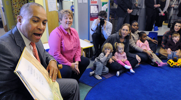"""Ipswich:<br /> Gov. Deval Patrick reads the book """"Guess How Much I Love You"""" by Sam McBratney during his visit at the Birth to Three's Family Center in Ipswich. Family educator Dianna Ryan is to the right of the governor who also read a portion of the book.<br /> Photo by Ken Yuszkus/The Salem News, Thursday, February 14, 2013."""
