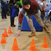 "Danvers:<br /> St. John's Prep freshman Aidan Crowley of Topsfield  tries the ""standing reach for balance"" activity at the Lahey Clinic table during the first ever wellness fair for students at St. John's Prep. <br /> Photo by Ken Yuszkus/The Salem News, Thursday, February 28, 2013."