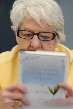 Hamilton:<br /> Barbara Essensa looks over a suggested book during the Readers Club meeting. The Readers Club is celebrating 45 years as a club.<br /> Photo by Ken Yuszkus/The Salem News, Monday, February 4, 2013.