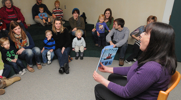 Beverly:<br /> Children's librarian Margie McClory-Bonefant reads a book to the people gathered at the Toddler Story Time at the Beverly Public Library on Wednesday morning.<br /> Photo by Ken Yuszkus/The Salem News, Wednesday, February 20, 2013.