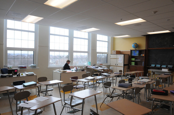 Salem:<br /> Teacher Gail Titus sits at her desk in her classroom on the top floor at the Collins Middle School. The new windows brighten the room.<br /> Photo by Ken Yuszkus/The Salem News, Tuesday, February 26, 2013.