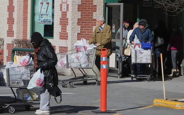 Salem:<br /> People exit Market Basket with cart loads of groceries.<br /> Photo by Ken Yuszkus/The Salem News, Thursday, February 7, 2013.