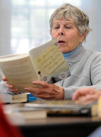 Hamilton:<br /> Connie Codd thumbs through a book during the Readers Club meeting. The Readers Club is celebrating 45 years as a club.<br /> Photo by Ken Yuszkus/The Salem News, Monday, February 4, 2013.