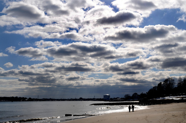 Beverly:<br /> Donna Robinson and Zachary Adinolfi walk along Dane Street Beach as the clouds roll in on Monday afternoon.<br /> Photo by Ken Yuszkus/The Salem News, Monday, February 25, 2013.