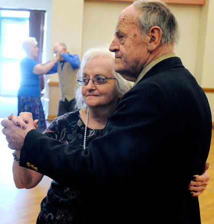 Peabody:<br /> Francis Loveys, left, and Leslie Covey dance to the live music of the Golden Echoes Dance Band at the Peter A. Torigian Community Center. Every Thursday morning they have bigband dancing at the center which draws a large crowd.<br /> Photo by Ken Yuszkus/The Salem News, Thursday, February 21, 2013.