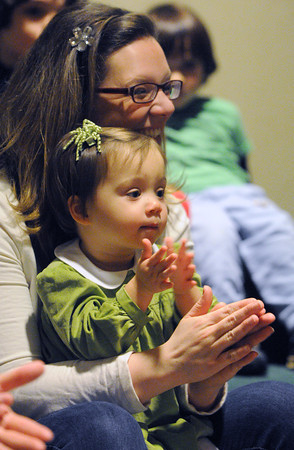 Beverly:<br /> Ginger Jones, 22 months old, and her mother Lauren clap and sing a song during the Toddler Story Time at the Beverly Public Library on Wednesday morning.<br /> Photo by Ken Yuszkus/The Salem News, Wednesday, February 20, 2013.