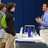 Danvers:<br /> St. John's Prep freshmen Quinlan Byrne, left, and Eric Rybicki listen to Dr. T.J. Macari at the New England Family Osteopathy table during the first ever wellness fair for students at St. John's Prep. <br /> Photo by Ken Yuszkus/The Salem News, Thursday, February 28, 2013.