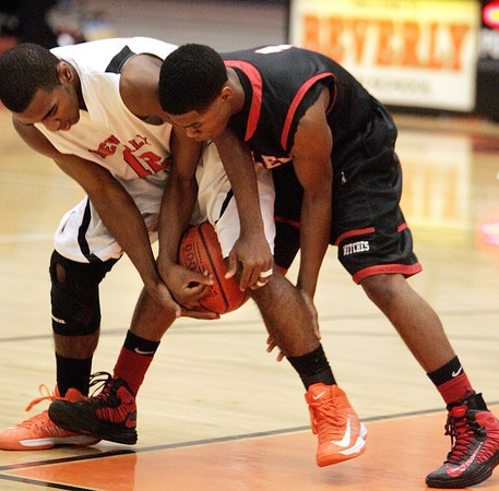 Beverly:<br /> Beverly's Jonangel Franco and Salem's Christian Dunston wrestle for the ball during the Salem at Beverly boys basketball game.<br /> Photo by Ken Yuszkus/The Salem News, Friday, February 15, 2013.