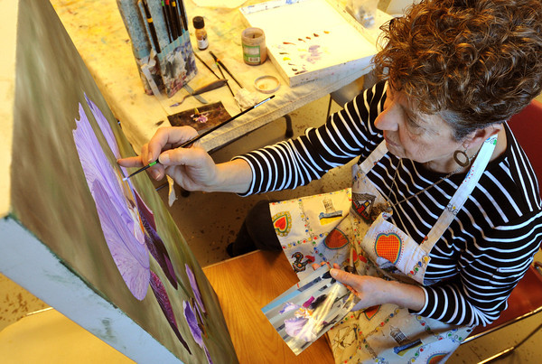 Peabody:<br /> Linda Mendonca of Peabody works on her oil painting, Iris, during the oil painting program at the Peter A. Torigian Community Center Thursday morning.<br /> Photo by Ken Yuszkus/The Salem News, Thursday, February 21, 2013.