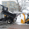 Salem:<br /> City workers remove snowpiles on Front Street at Central Street in Salem.<br /> Photo by Ken Yuszkus/The Salem News, Monday, February 11, 2013.