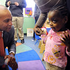 Ipswich:<br /> Gov. Deval Patrick speaks with student Syesha Walker as they break for snacks after the governor read a book during his visit at the Birth to Three's Family Center in Ipswich. <br /> Photo by Ken Yuszkus/The Salem News, Thursday, February 14, 2013.
