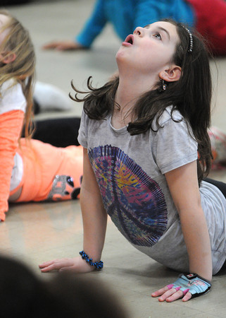 Danvers:<br /> Abigail Malone, 7, learns yoga at the Hip Hop Girls Club program at the Thorpe School in Danvers this week.<br /> Photo by Ken Yuszkus/The Salem News, Tuesday, February 19, 2013.