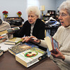 Hamilton:<br /> From left, Elisa Cowhig, Nancy Monaco, and June Nichols talk about the books they read while attending the Readers Club meeting. The Readers Club is celebrating 45 years as a club.<br /> Photo by Ken Yuszkus/The Salem News, Monday, February 4, 2013.