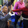Ipswich:<br /> Gov. Deval Patrick high fives student Molly Pietal as they break for snacks after the governor read a book during his visit at the Birth to Three's Family Center in Ipswich. <br /> Photo by Ken Yuszkus/The Salem News, Thursday, February 14, 2013.