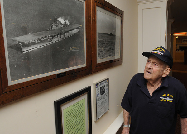 Danvers:<br /> Bob Hayes is a WWII veteran who served on USS Essex. He is standing next to his display at the Brightview Senior Living housing where he recently moved.<br /> Photo by Ken Yuszkus/The Salem News, Wednesday, February 13, 2013.