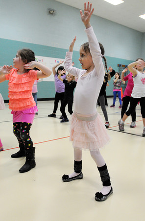 Danvers:<br /> Madelyn Richards, 5 1/2, left, and Emily Mahoney, 5, move to the music in their hip hop dance class during the Hip Hop Girls Club program at the Thorpe School in Danvers this week.<br /> Photo by Ken Yuszkus/The Salem News, Tuesday, February 19, 2013.