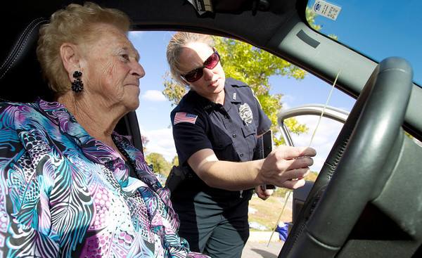 Danvers Police Officer Suzanne Tibbetts, right, measures the distance above the steering wheel for Gloria Lipinski, left, a Danvers resident as part of a 'CarFit' program that will be available for all Danvers senior citizens to help them be safe while driving. David Le/Staff Photo