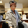 Ruth Mannis, of Lynn, sports a spider headband while looking through merchandise in Bernard's Jewelers on Saturday afternoon. David Le/Staff Photo