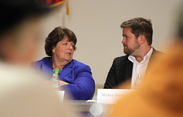 Panelists Christine Sullivan, left, and Mickey Northcutt, chat before the start of the Community Preservation Act Forum at the Moose Lodge on Wednesday evening. David Le/Staff Photo