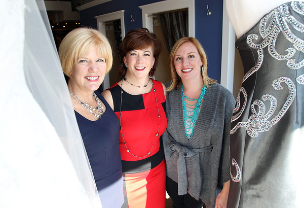 Jeanna Hennessey, left, owner of Lorraine Roy, and Co-Owners Heidi Nicholson and Lisa Almeida, right, of Bella Sera Bridal, will merge businesses come January 2013.  David Le/Staff Photo