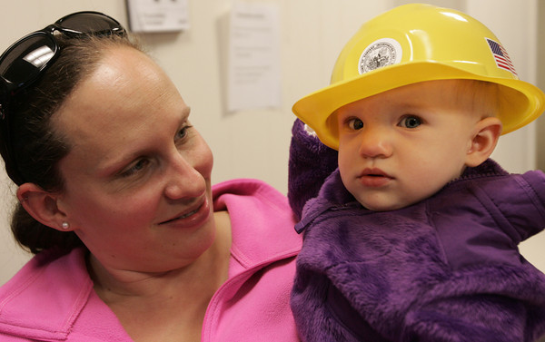 Danvers:<br /> Natalie Daniels, 8 months old, right, got a free hard hat at the code administrator's office in Danvers Town Hall during the annual townwide open house. Her mother Amanda looks on.<br /> Photo by Ken Yuszkus/The Salem News, Thursday, October 11, 2012.