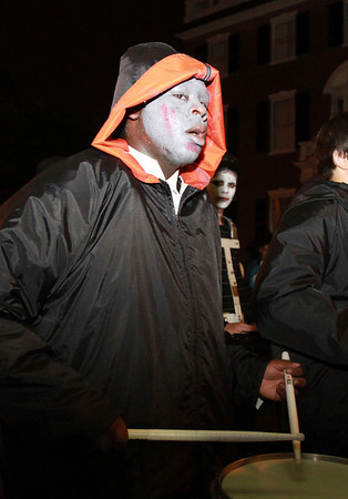 Beverly High School senior Jose Sanchez, plays his drum and marches in time during the annual Halloween Parade in Salem. David Le/Staff Photo
