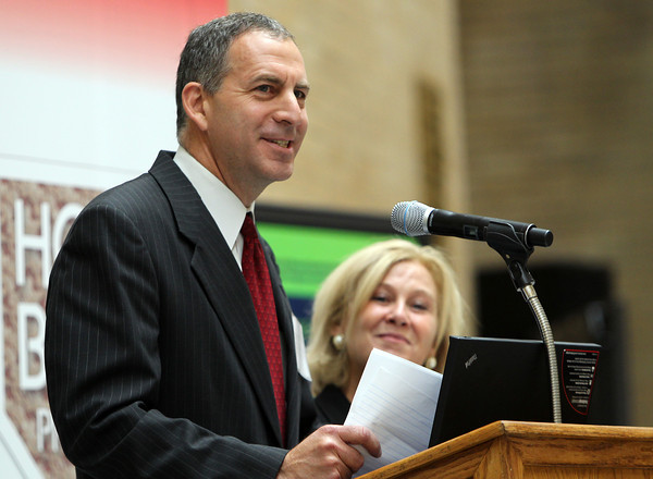 """State Representative Jerry Parisella, of Beverly, makes a joke while addressing a large group of people gathered in the Hall of Flags at the State House in Boston on Monday morning. Parisella and his wife Lisa, are part of a Home Base Program called """"Staying Strong,"""" which provides support to military families at home and in school. David Le/Staff Photo"""
