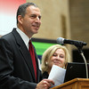 "State Representative Jerry Parisella, of Beverly, makes a joke while addressing a large group of people gathered in the Hall of Flags at the State House in Boston on Monday morning. Parisella and his wife Lisa, are part of a Home Base Program called ""Staying Strong,"" which provides support to military families at home and in school. David Le/Staff Photo"