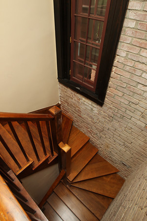 A renovated stairwell in one of the short term housing units inside the Coach House at Willowdale Estate. David Le/Staff Photo